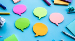 Colorful Speech Bubble Shapes And Adhesive Notes On Blue Background